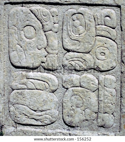 Ancient Mayan glyphs (writing) in stone tablet
