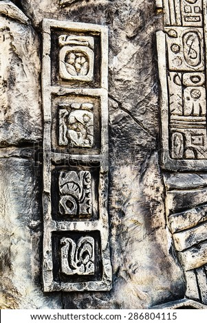 Ancient Mayan hieroglyphics in stone, from the ruins - stock photo