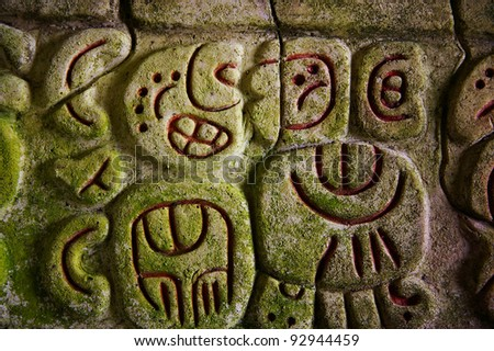 Ancient Mayan hieroglyphics in stone, from the ruins at Caracol, Belize - stock photo