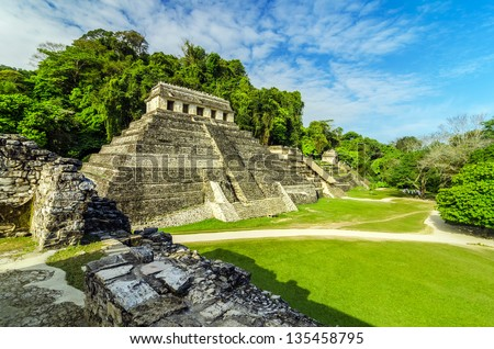 Ancient Mayan temples in the ruined city of Palenque - stock photo