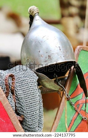 ancient medieval knights helmet during the period of the middle ages - stock photo