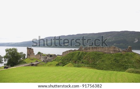 Ancient medieval Urquhart castle on the shore of Loch Ness in Scotland - stock photo