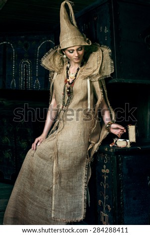 Ancient Medieval woman in costume from gunny sacking - stock photo