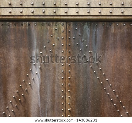 ancient metal wall texture with rivet - stock photo