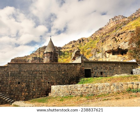 Ancient monastery in the mountains. View of wall and church of the thirteenth century - stock photo