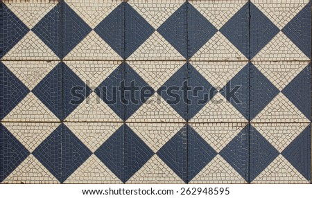 Ancient mosaic floor, checkered pattern - stock photo