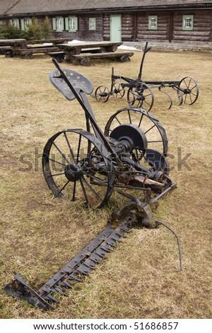 Ancient mowing machine - stock photo