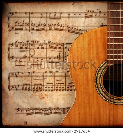 ancient music sheet, rusted old yellow paper with guitar - stock photo