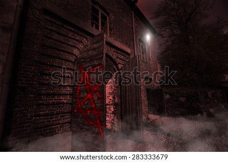 ancient mysterious scary house in the night - stock photo