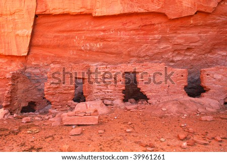 Ancient Navajo Anasazi dwelling with petroglyphs in Mystery Valley - stock photo