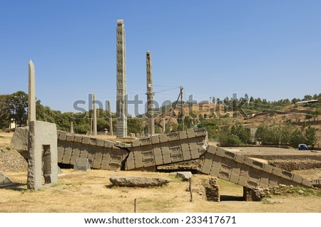 Ancient obelisks, Aksum, Ethiopia. Symbol of the Aksumite civilization, the most powerful between Eastern Roman Empire and Persia between the 1st and the 13th century A.D. UNESCO World Heritage site. - stock photo