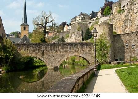 Ancient Old City Wall In Luxembourg Grund - stock photo