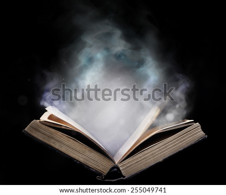 Ancient open book in the magical smoke - stock photo
