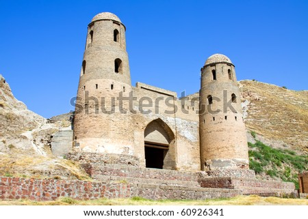 Ancient oriental fortress under blue sky - stock photo
