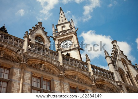 Ancient ornate building in Gent Belgium, against the sky - stock photo