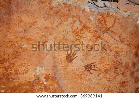 Ancient painted by hand at Pa Tam National Park in the Ubon Ratchathani province , Thailand - stock photo