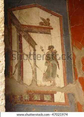 Ancient painted wall fresco at the ancient Roman city of Herculaneum, which was destroyed and buried during the eruption of Mount Vesuvius in 79 AD - stock photo