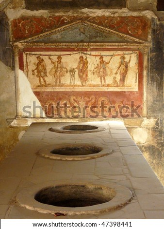 Ancient painted wall fresco at the ancient Roman city of Pompeii, which was destroyed and buried during the eruption of Mount Vesuvius in 79 AD - stock photo