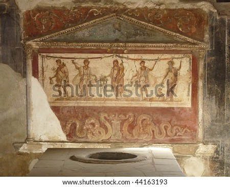 Ancient painted wall frescoes at the ancient Roman city of Pompeii, which was destroyed and buried by ash during the eruption of Mount Vesuvius in 79 AD - stock photo