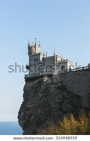 Ancient palace with towers at the edge of a cliff