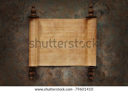 Ancient parchment scrolls with blank papyrus opened on a stone background with clipping path - stock photo