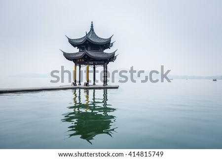 ancient pavilion on hangzhou west lake in mist rain ,China - stock photo