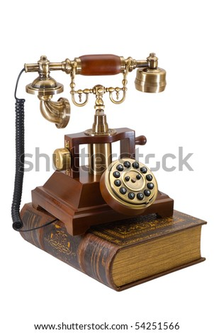 Ancient phone and book are photographed on the white background