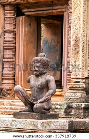 Ancient pink stone guardian statue carvings in Banteay Srei, Siem reap, Cambodia. - stock photo