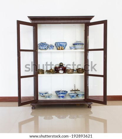Ancient porcelain bowl and brass in antique wood - stock photo