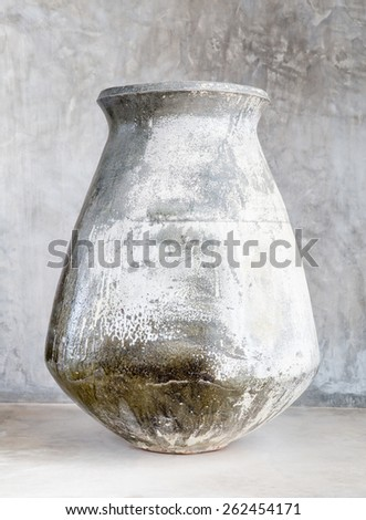 Ancient pot isolated over white - stock photo