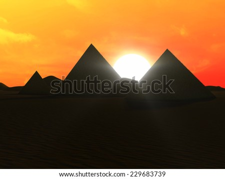 Ancient Pyramids in Desert at Sunset - stock photo
