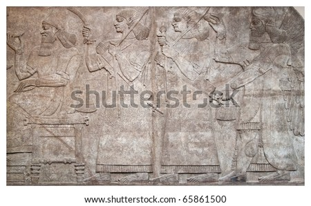 Ancient relief of assyrian winged gods and archers - stock photo