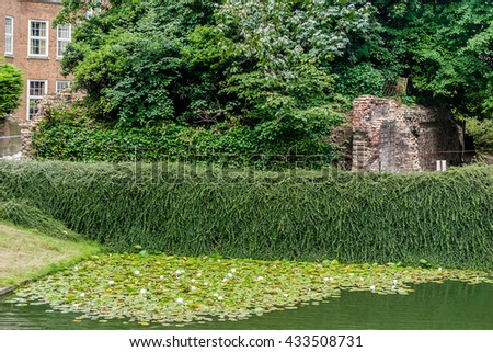 Ancient remains of old Roman city walls. Barbican Estate in London, UK. London Wall, built to protect the Roman settlement of Londinium in the second - third century. - stock photo