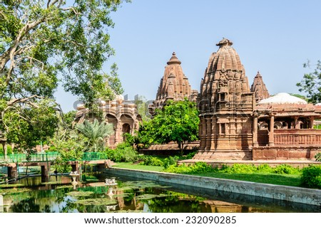 Ancient rock curved temples of Hindu Gods and goddess at Mandor garden, Jodhpur, Rajasthan, India - stock photo