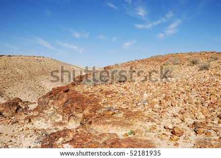 Ancient rocks under blue sky. Desert Negev, Israel.