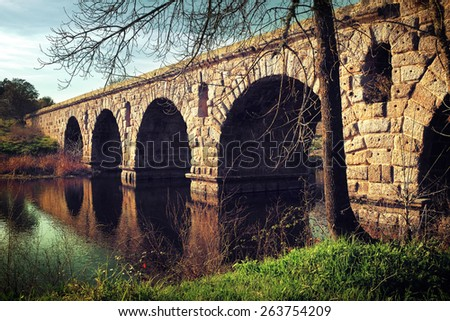 Ancient Roman bridge in Alter do Chao, Portugal - stock photo