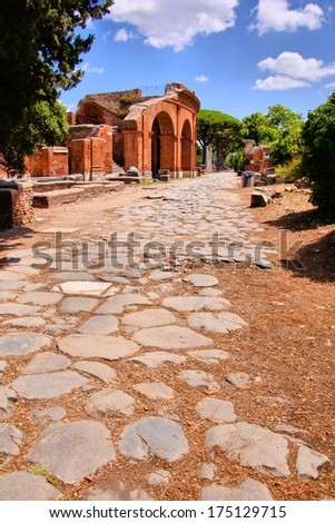 Ancient Roman road through Ostia Antica, Rome, Italy - stock photo
