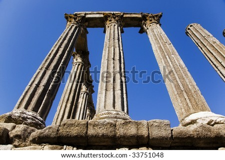 Ancient roman ruins over the blue sky. - stock photo