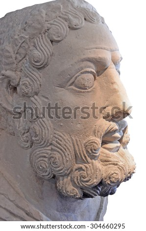 Ancient roman sculpture of the head of Hercules. Isolated against a white background - stock photo