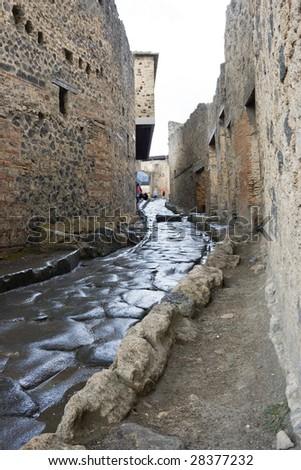Ancient roman street in Pompeii - stock photo
