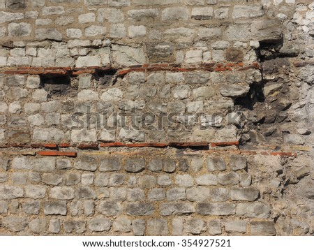 Ancient Roman wall ruins in London, UK - stock photo