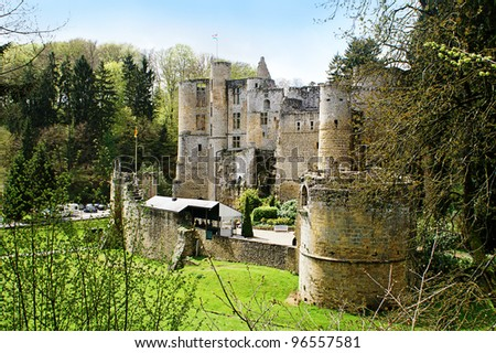 ancient ruin of an old picturesque castle in luxembourg on a sunny day - stock photo