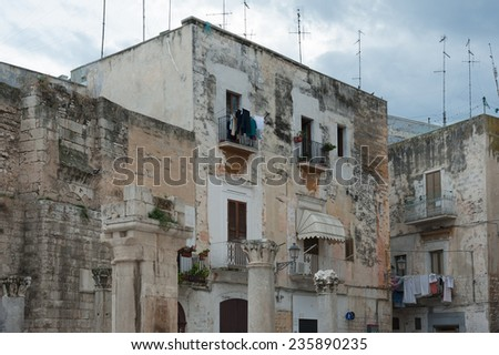 Ancient ruin pillars and buildings in the old town of Bari, Apulia, Italy - stock photo