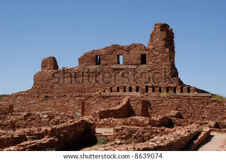Ancient ruin site in New Mexico on a sunny day - dramatic against clear blue sky - stock photo