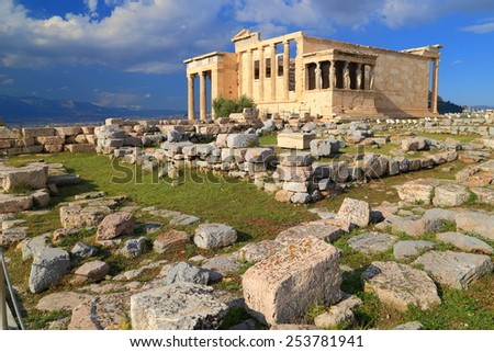 Ancient ruins and sunny Erechtheion temple on the Athens Acropolis, Greece - stock photo