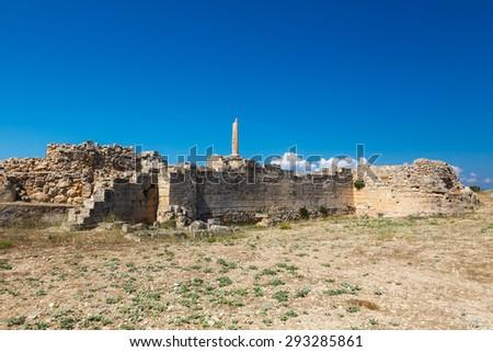 Ancient ruins in Aegina acropolis against a blue sky in Aegina island, Greece - stock photo