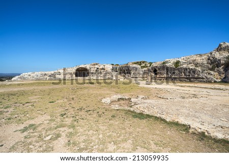 Ancient ruins of Greek Theatre ruins in Syracuse, Sicily - stock photo