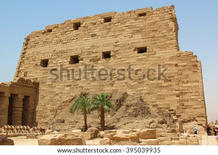 Ancient ruins of Karnak temple, the external fortress wall with loopholes, Luxor, Thebes, Egypt - stock photo
