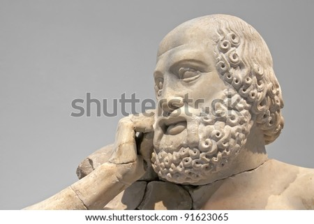 Ancient ruins of the Philippeion at Olympia, Greece. Detail of an ancient Greek statue of a human. Site of the ancient Olympic Games is situated on the Peloponnese. UNESCO world heritage site. - stock photo