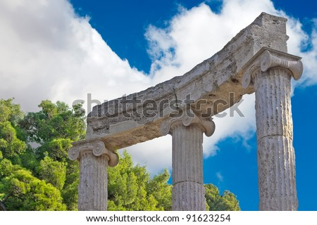 Ancient ruins of the Philippeion at Olympia, Greece. Detailed view of the Philippeion, showing the construction of the crepidoma. UNESCO world heritage site. - stock photo